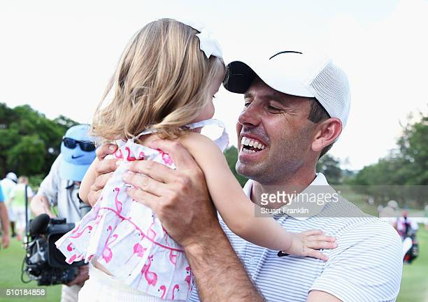 Charl Schwartzel of South Africa celebrates victory with his daughter after the final round of the Tshwane Open at Pretoria Country Club on February...