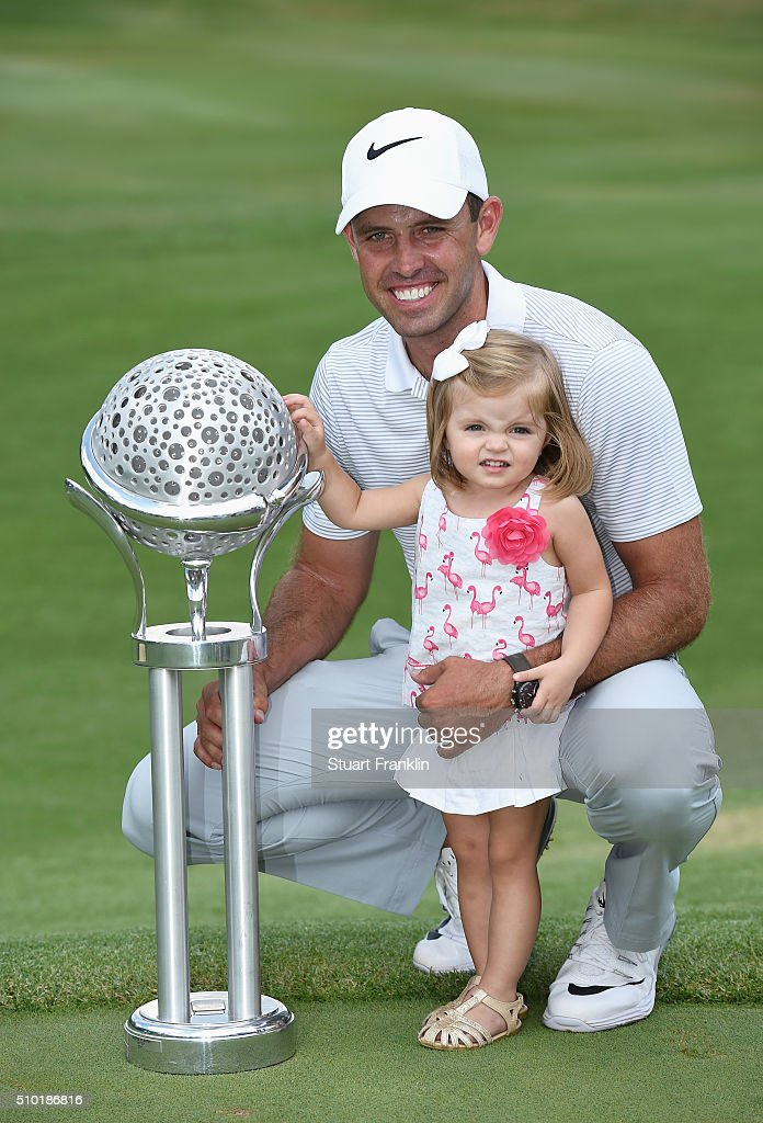Charl Schwartzel of South Africa celebrates victory with his daughter and the trophy after the final round of the Tshwane Open at Pretoria Country Club on February 14, 2016 in Pretoria, South Africa.