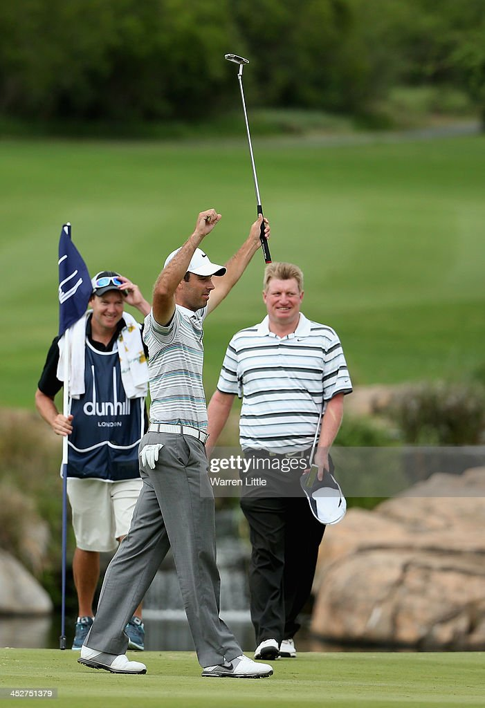 Charl Schwartzel of South Africa celebrates winning the Alfred Dunhill Championship on a score of -17 under par at Leopard Creek Country Club on December 1, 2013 in Malelane, South Africa.