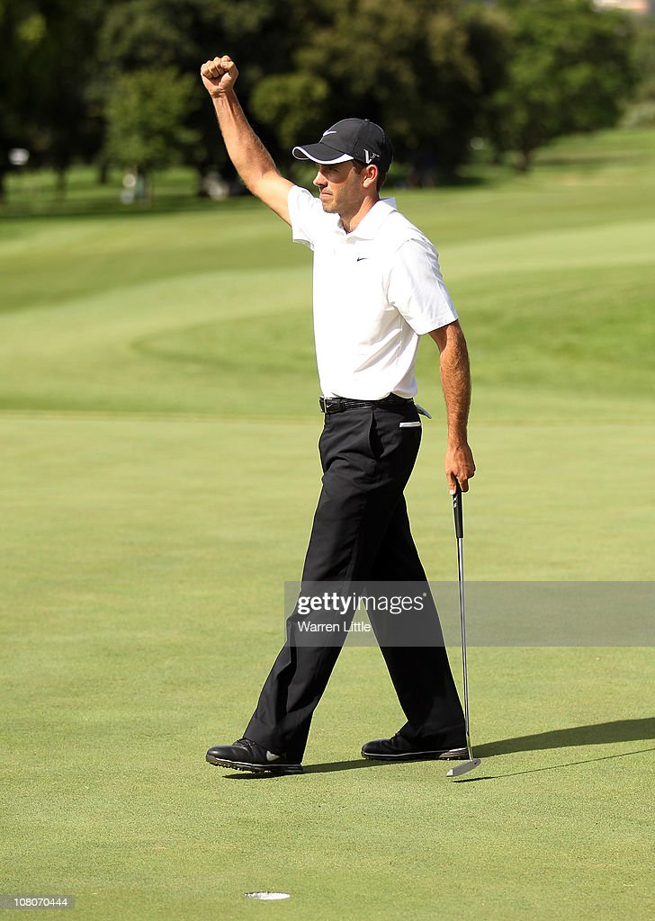 Charl Schwartzel of South Africa celebrates winning the Joburg Open at Royal Johannesburg and Kensington Golf Club on a score of -19 under par on January 16, 2011 in Johannesburg, South Africa.