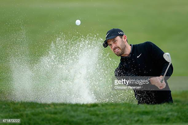 Charl Schwartzel of South Africa chips from the bunker onto the 20th hole during round three of the World Golf Championships Cadillac Match Play at...