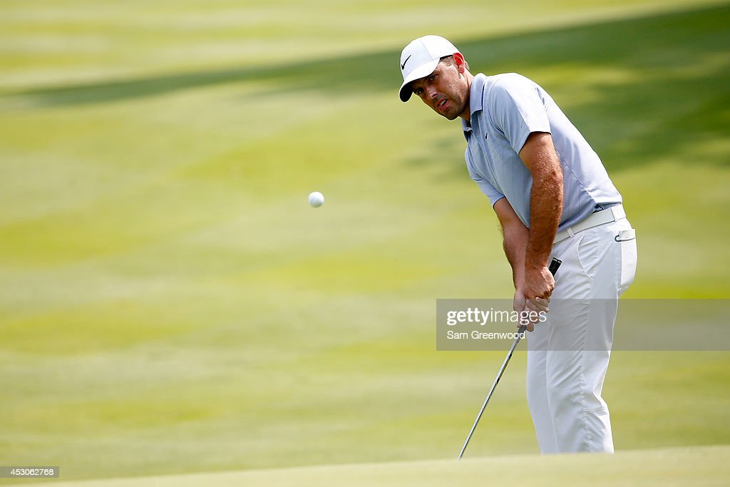 Charl Schwartzel of South Africa chips onto the ninth green during the second round of the World Golf Championships-Bridgestone Invitational at Firestone Country Club South Course on August 1, 2014 in Akron, Ohio.