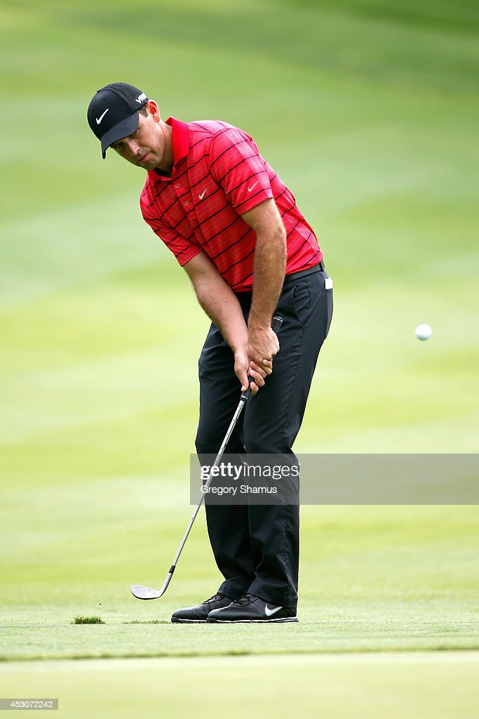 Charl Schwartzel of South Africa chips onto the sixth green during the third round of the World Golf Championships-Bridgestone Invitational at Firestone Country Club South Course on August 2, 2014 in Akron, Ohio.