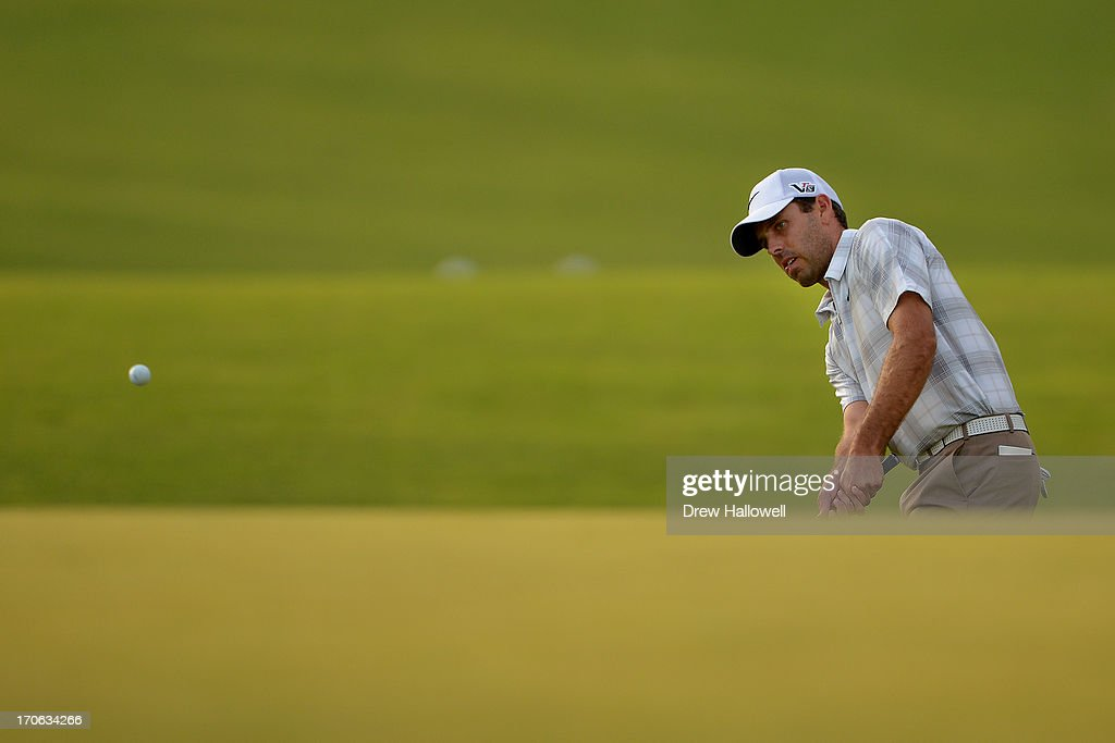 <a gi-track='captionPersonalityLinkClicked' href=/galleries/search?phrase=Charl+Schwartzel&family=editorial&specificpeople=213793 ng-click='$event.stopPropagation()'>Charl Schwartzel</a> of South Africa chips to the 18th green during Round Three of the 113th U.S. Open at Merion Golf Club on June 15, 2013 in Ardmore, Pennsylvania.