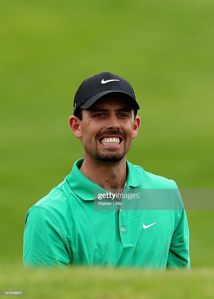 Charl Schwartzel of South Africa grimaces during the final round of the Nedbank Golf Challenge at the Gary Player Country Club on December 2, 2012 in Sun City, South Africa.