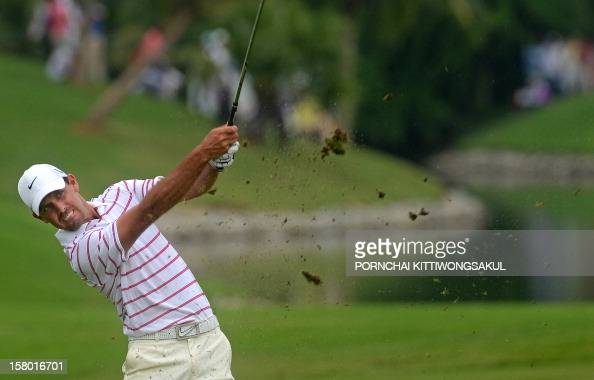 Charl Schwartzel of South Africa hits a shot during the final round of the 1 million USD Thailand Golf Championship at the par72 Amata Spring Country...