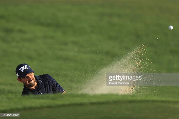 Charl Schwartzel of South Africa hits from a bunker on the 18th hole during day four of the DP World Tour Championship at Jumeirah Golf Estates on...