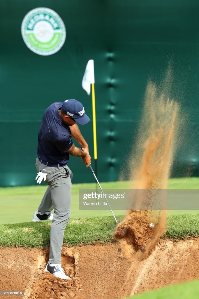 Charl Schwartzel of South Africa hits from a bunker on the 18th hole during the third round of the Nedbank Golf Challenge at Gary Player CC on November 11, 2017 in Sun City, South Africa.