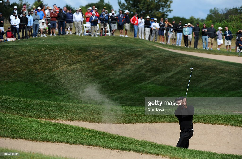 <a gi-track='captionPersonalityLinkClicked' href=/galleries/search?phrase=Charl+Schwartzel&family=editorial&specificpeople=213793 ng-click='$event.stopPropagation()'>Charl Schwartzel</a> of South Africa hits from bunker on the seventh hole during the second round of the BMW Championship at Conway Farms Golf Club on September 13, 2013 in Lake Forest, Illinois.