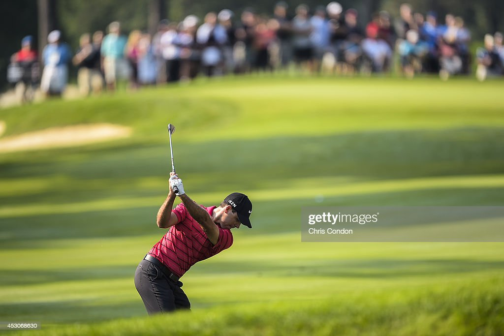 Charl Schwartzel of South Africa hits from the fairway on the first hole during the third round of the World Golf Championships-Bridgestone Invitational at Firestone Country Club on August 2, 2014 in Akron, Ohio.