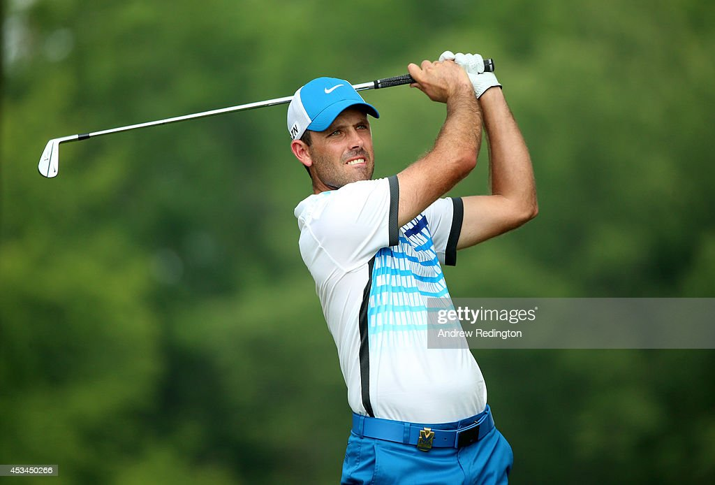 Charl Schwartzel of South Africa hits his tee shot on the 12th hole during the final round of the 96th PGA Championship at Valhalla Golf Club on August 10, 2014 in Louisville, Kentucky.
