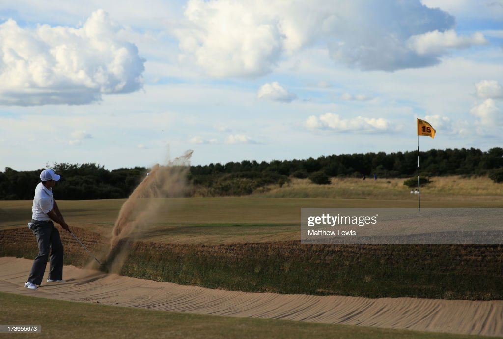 Charl Schwartzel of South Africa hits out of the bunker on the 15th hole during the first round of the 142nd Open Championship at Muirfield on July 18, 2013 in Gullane, Scotland.