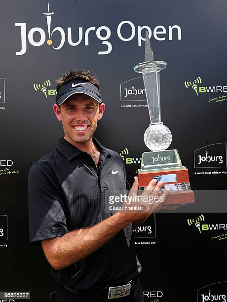 Charl Schwartzel of South Africa holds the winner's trophy at the Joburg Open at Royal Johannesburg and Kensington Golf Club on January 17 2010 in...