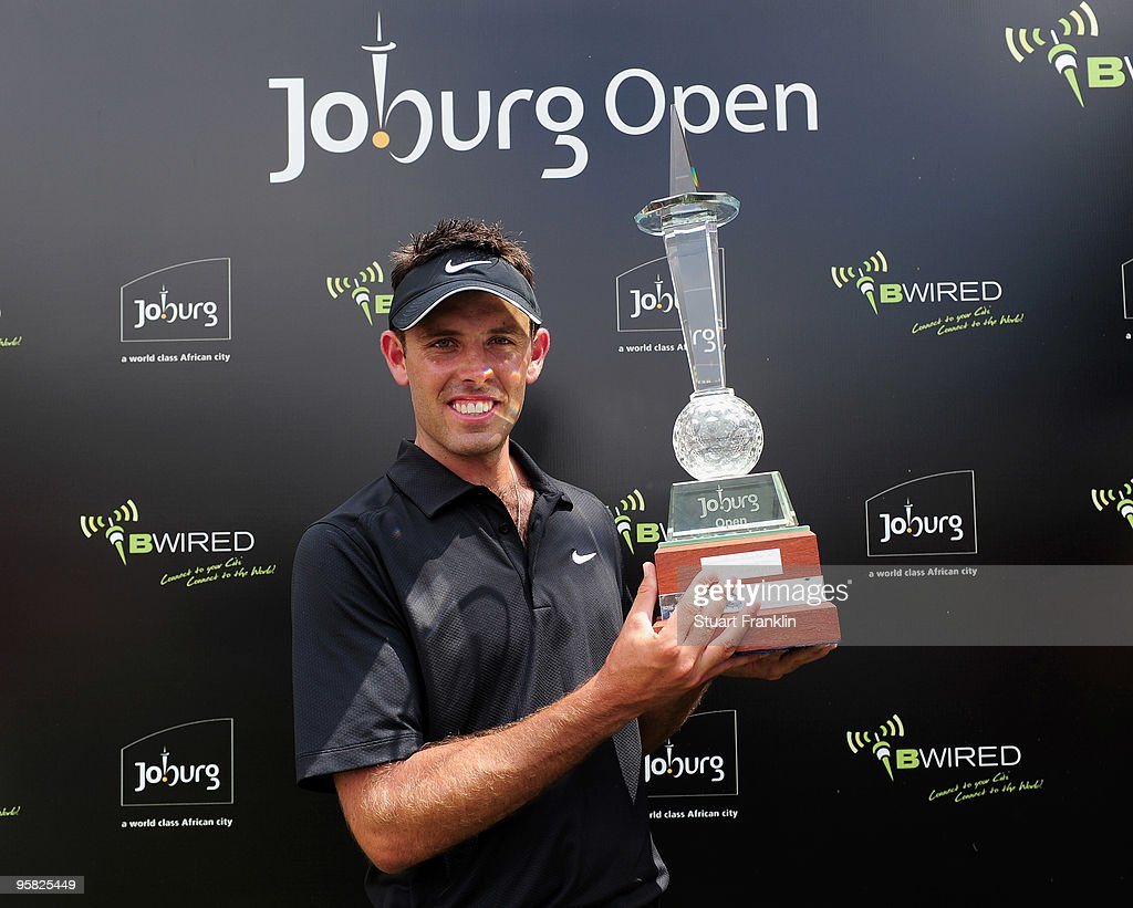 Charl Schwartzel of South Africa holds the winner's trophy at the Joburg Open at Royal Johannesburg and Kensington Golf Club on January 17, 2010 in Johannesburg, South Africa.