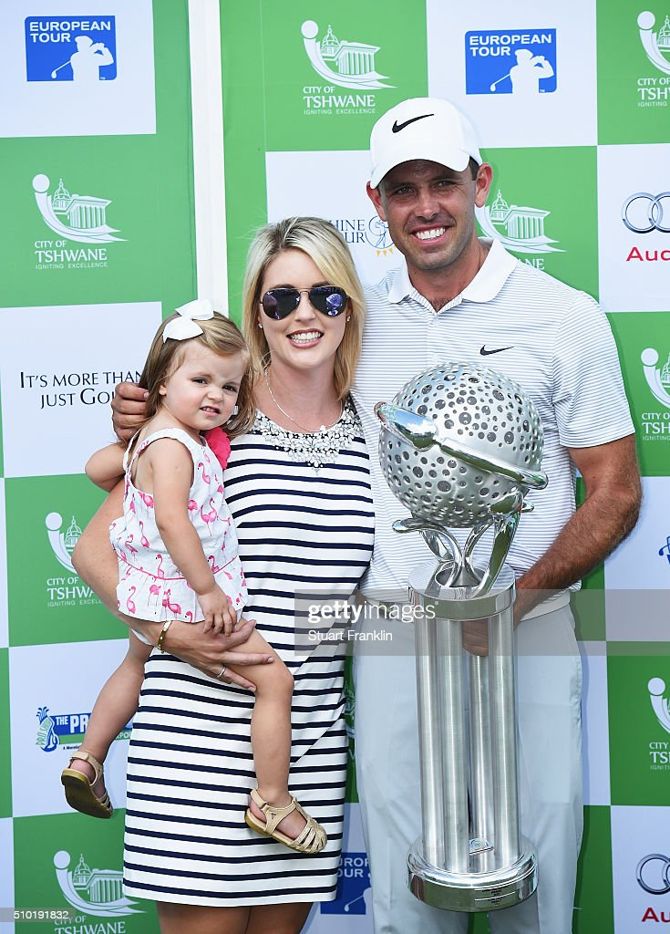 <a gi-track='captionPersonalityLinkClicked' href=/galleries/search?phrase=Charl+Schwartzel&family=editorial&specificpeople=213793 ng-click='$event.stopPropagation()'>Charl Schwartzel</a> of South Africa holds the winners trophy with his wife Rosalind Schwartzel and daughter Olivia Schwartzel after the final round of the Tshwane Open at Pretoria Country Club on February 14, 2016 in Pretoria, South Africa.