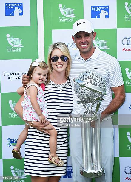 Charl Schwartzel of South Africa holds the winners trophy with his wife Rosalind Schwartzel and daughter Olivia Schwartzel after the final round of...