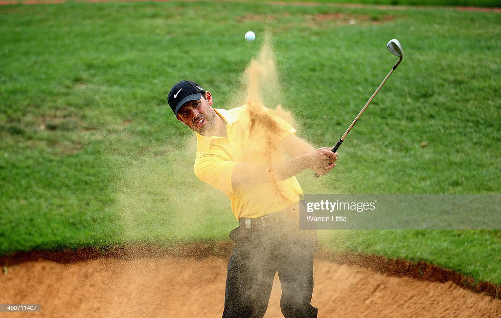 <a gi-track='captionPersonalityLinkClicked' href=/galleries/search?phrase=Charl+Schwartzel&family=editorial&specificpeople=213793 ng-click='$event.stopPropagation()'>Charl Schwartzel</a> of South Africa in action during a practice round ahead of the South African Open Championship at Glendower Golf Club on November 20, 2013 in Johannesburg, South Africa.