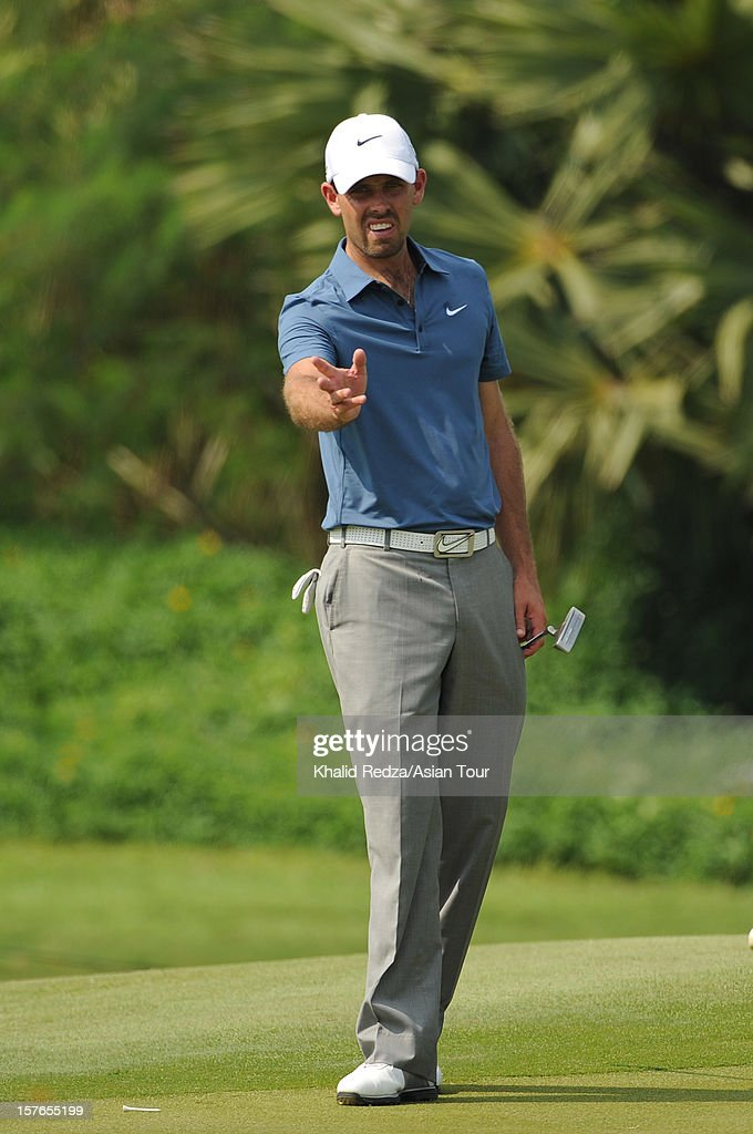 <a gi-track='captionPersonalityLinkClicked' href=/galleries/search?phrase=Charl+Schwartzel&family=editorial&specificpeople=213793 ng-click='$event.stopPropagation()'>Charl Schwartzel</a> of South Africa in action during previews ahead of the Thailand Golf Championship at Amata Spring Country Club on December 5, 2012 in Bangkok, Thailand.
