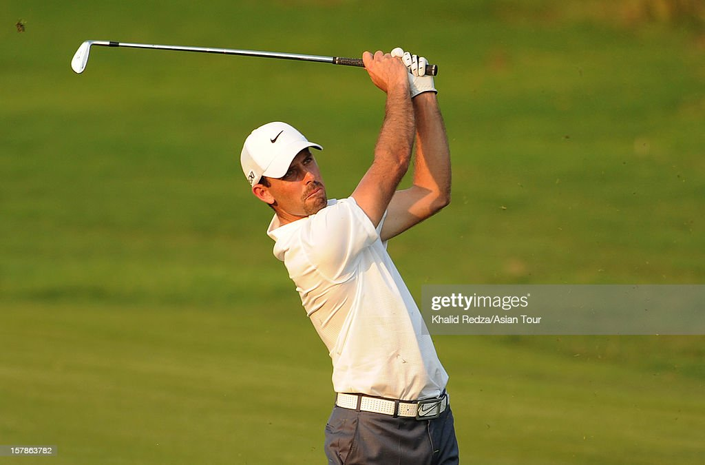 <a gi-track='captionPersonalityLinkClicked' href=/galleries/search?phrase=Charl+Schwartzel&family=editorial&specificpeople=213793 ng-click='$event.stopPropagation()'>Charl Schwartzel</a> of South Africa in action during round two of the Thailand Golf Championship at Amata Spring Country Club on December 7, 2012 in Bangkok, Thailand.