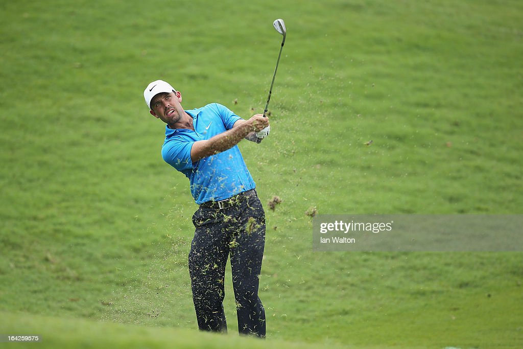 <a gi-track='captionPersonalityLinkClicked' href=/galleries/search?phrase=Charl+Schwartzel&family=editorial&specificpeople=213793 ng-click='$event.stopPropagation()'>Charl Schwartzel</a> of South Africa in action during the second round of the Maybank Malaysian Open at Kuala Lumpur Golf & Country Club on March 22, 2013 in Kuala Lumpur, Malaysia.