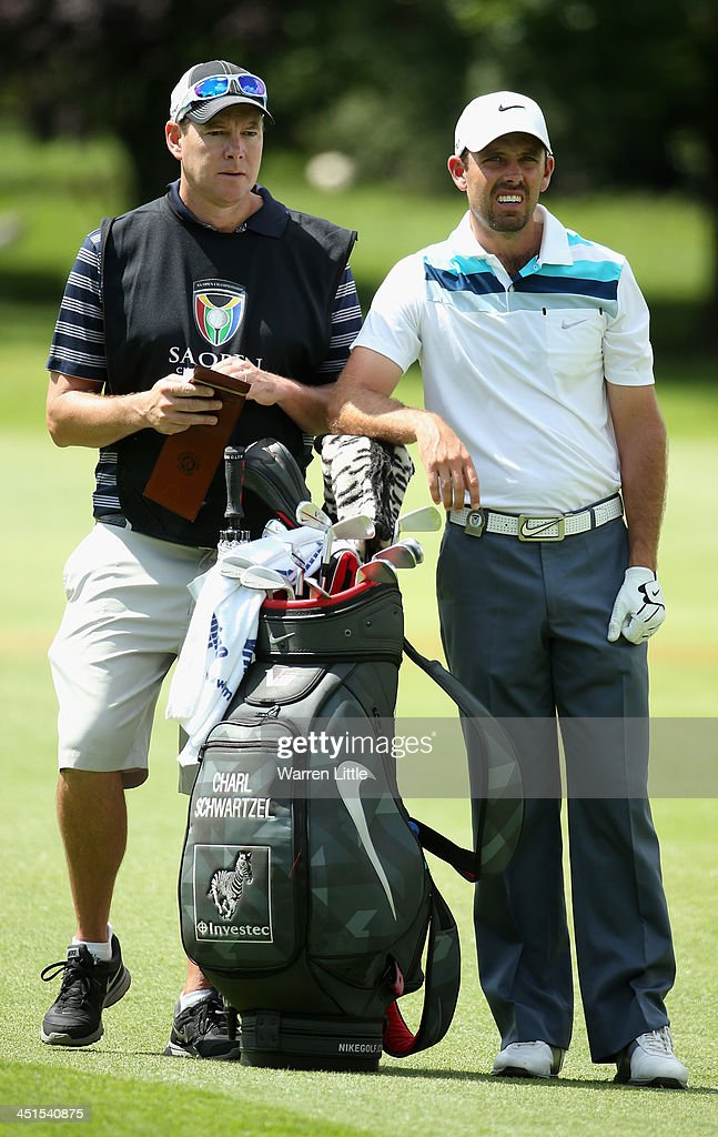 <a gi-track='captionPersonalityLinkClicked' href=/galleries/search?phrase=Charl+Schwartzel&family=editorial&specificpeople=213793 ng-click='$event.stopPropagation()'>Charl Schwartzel</a> of South Africa in action during the third round of the South African Open Championship at Glendower Golf Club on November 23, 2013 in Johannesburg, South Africa.