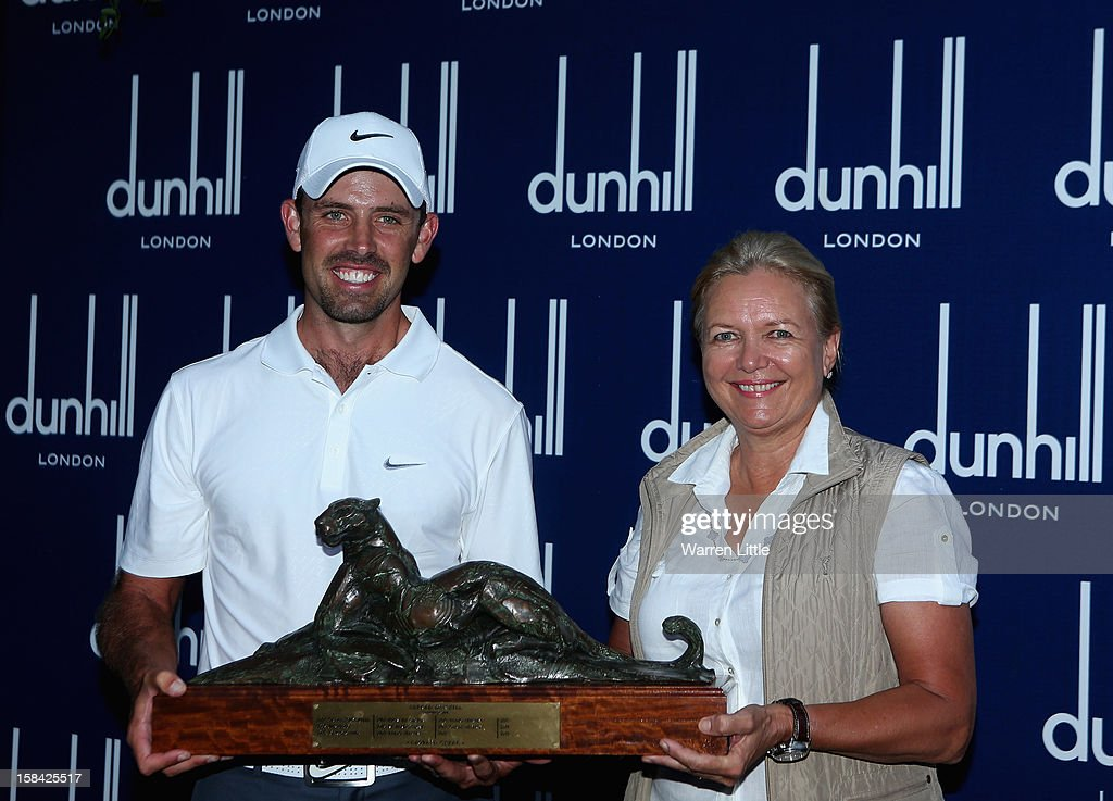 Charl Schwartzel of South Africa is presented the trophy by Gaynor Rupert, wife of Johann Rupert, CEO of Dunhill after winning the Alfred Dunhill Championship on a score of -24 at Leopard Creek Country Golf Club on December 16, 2012 in Malelane, South Africa.