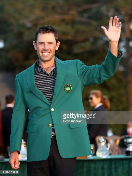 Charl Schwartzel of South Africa is presented with his Green Jacket after winning the Masters after the final round of the 2011 Masters Tournament at...