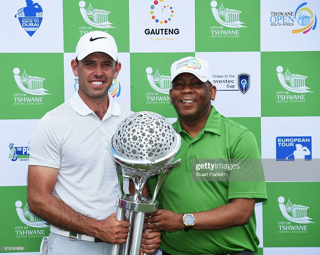 <a gi-track='captionPersonalityLinkClicked' href=/galleries/search?phrase=Charl+Schwartzel&family=editorial&specificpeople=213793 ng-click='$event.stopPropagation()'>Charl Schwartzel</a> of South Africa is prresented with the winners trophy by Kgosientso Ramokgopa, mayor of Tshwane after the final round of the Tshwane Open at Pretoria Country Club on February 14, 2016 in Pretoria, South Africa.