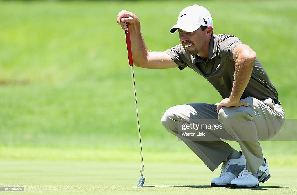 Charl Schwartzel of South Africa lines up a putt during the first round of the Nedbank Golf Challenge at the Gary Player Country Club on November 29, 2012 in Sun City, South Africa.