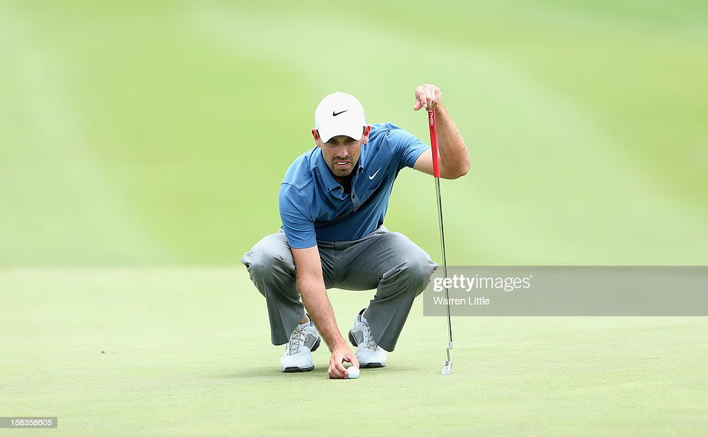 Charl Schwartzel of South Africa lines up a putt during the second round of the Alfred Dunhill Championship at Leopard Creek Country Golf Club on December 14, 2012 in Malelane, South Africa.
