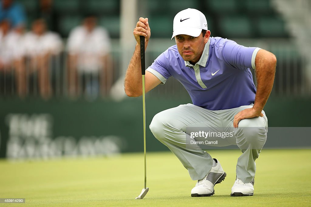 Charl Schwartzel of South Africa lines up a putt on the 18th green during the first round of The Barclays at The Ridgewood Country Club on August 21, 2014 in Paramus, New Jersey.