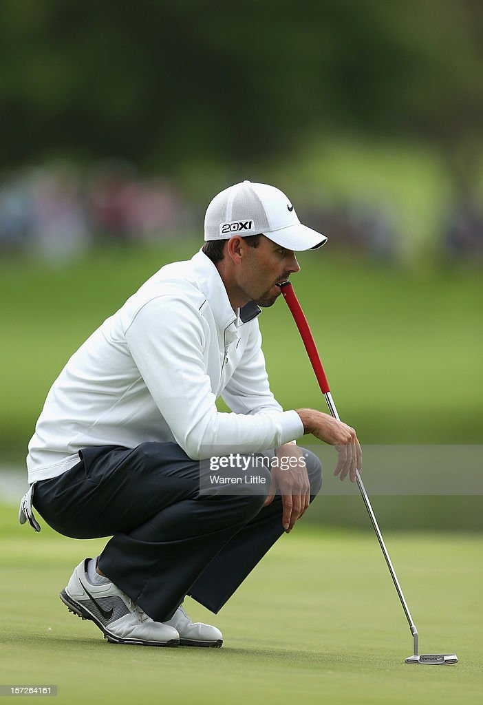 Charl Schwartzel of South Africa looks on from on the 18th green during the third round of the Nedbank Golf Challenge at the Gary Player Country Club on December 1, 2012 in Sun City, South Africa.