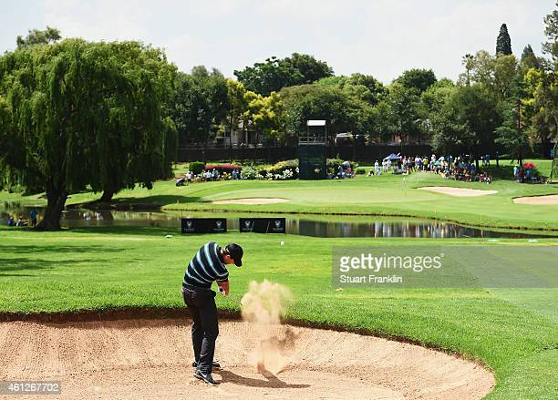 Charl Schwartzel of South Africa plays a bunker shot on the 10th hole during the third round of the South African Open at Glendower Golf Club on...