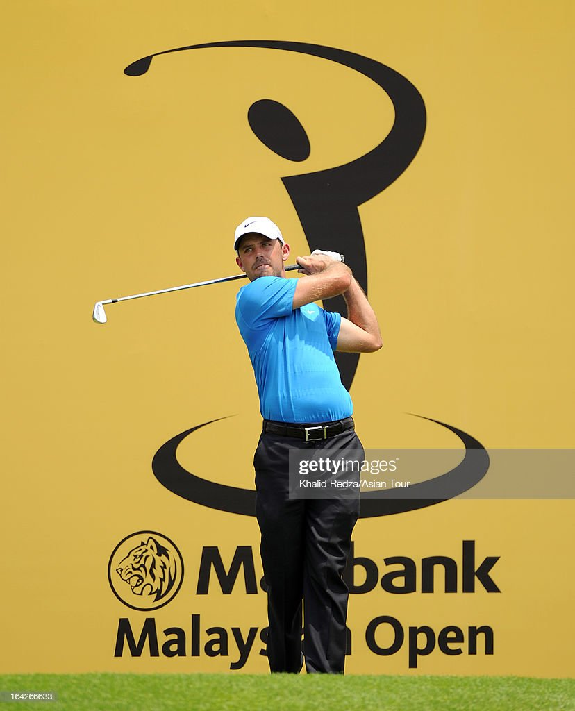 <a gi-track='captionPersonalityLinkClicked' href=/galleries/search?phrase=Charl+Schwartzel&family=editorial&specificpeople=213793 ng-click='$event.stopPropagation()'>Charl Schwartzel</a> of South Africa plays a shot during round two of the Maybank Malaysian Open at Kuala Lumpur Golf & Country Club on March 22, 2013 in Kuala Lumpur, Malaysia.