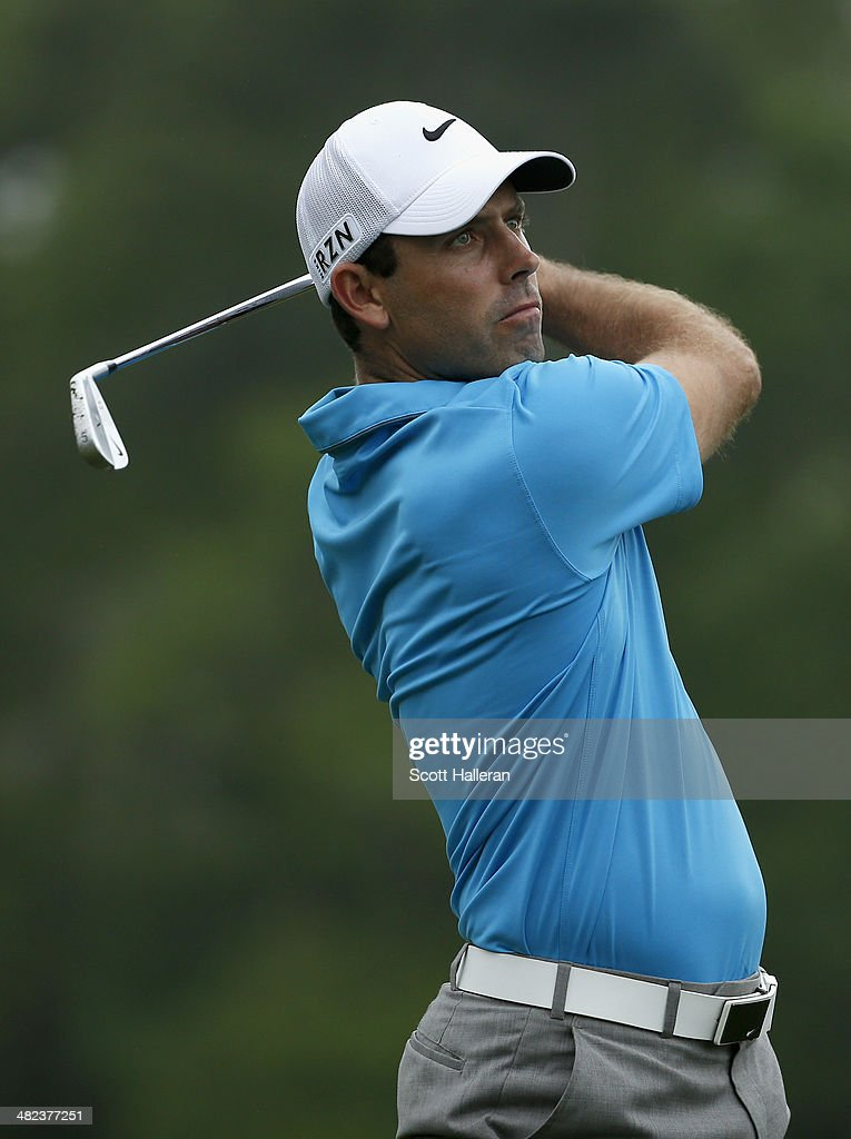 <a gi-track='captionPersonalityLinkClicked' href=/galleries/search?phrase=Charl+Schwartzel&family=editorial&specificpeople=213793 ng-click='$event.stopPropagation()'>Charl Schwartzel</a> of South Africa plays a shot on the ninth tee during round one of the Shell Houston Open at the Golf Club of Houston on April 3, 2014 in Humble, Texas.
