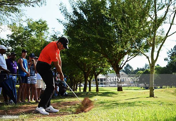 Charl Schwartzel of South Africa plays his approach shot on the 18th hole during the third round of the Tshwane Open at Pretoria Country Club on...