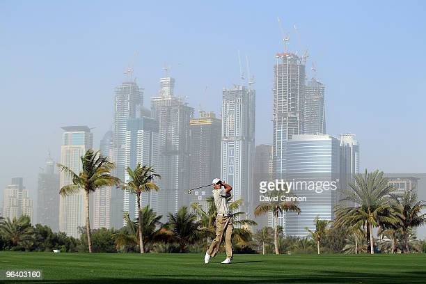 Charl Schwartzel of South Africa plays his second shot at the par 5 13th hole during the first round of the 2010 Omega Dubai Desert Classic on the...