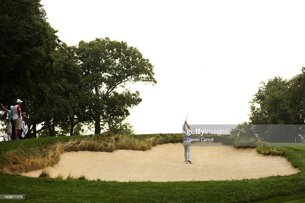 Charl Schwartzel of South Africa plays his second shot from a bunker on the seventh hole during the first round of The Barclays at The Ridgewood Country Club on August 21, 2014 in Paramus, New Jersey.