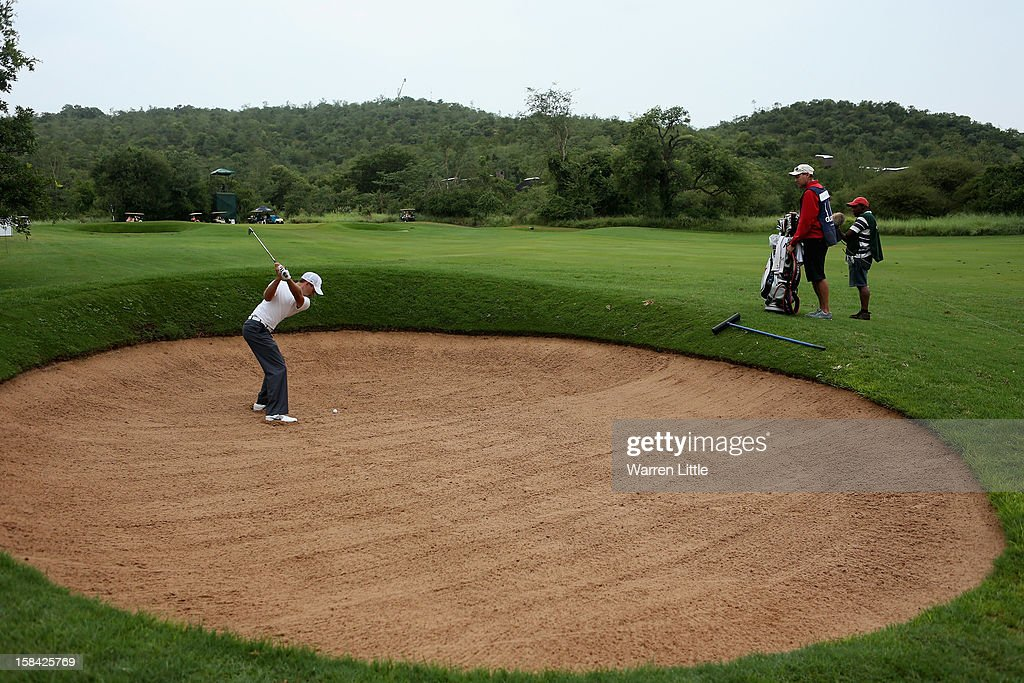 Charl Schwartzel of South Africa plays his second shot into the 11th green during the final round of the Alfred Dunhill Championship at Leopard Creek Country Golf Club on December 16, 2012 in Malelane, South Africa.