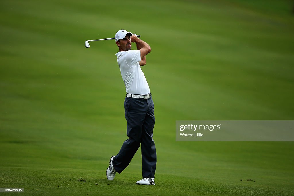 Charl Schwartzel of South Africa plays his second shot into the 13th green during the final round of the Alfred Dunhill Championship at Leopard Creek Country Golf Club on December 16, 2012 in Malelane, South Africa.