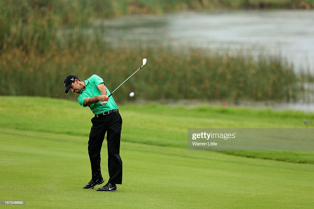 <a gi-track='captionPersonalityLinkClicked' href=/galleries/search?phrase=Charl+Schwartzel&family=editorial&specificpeople=213793 ng-click='$event.stopPropagation()'>Charl Schwartzel</a> of South Africa plays his second shot into the 17th green during the final round of the Nedbank Golf Challenge at the Gary Player Country Club on December 2, 2012 in Sun City, South Africa.