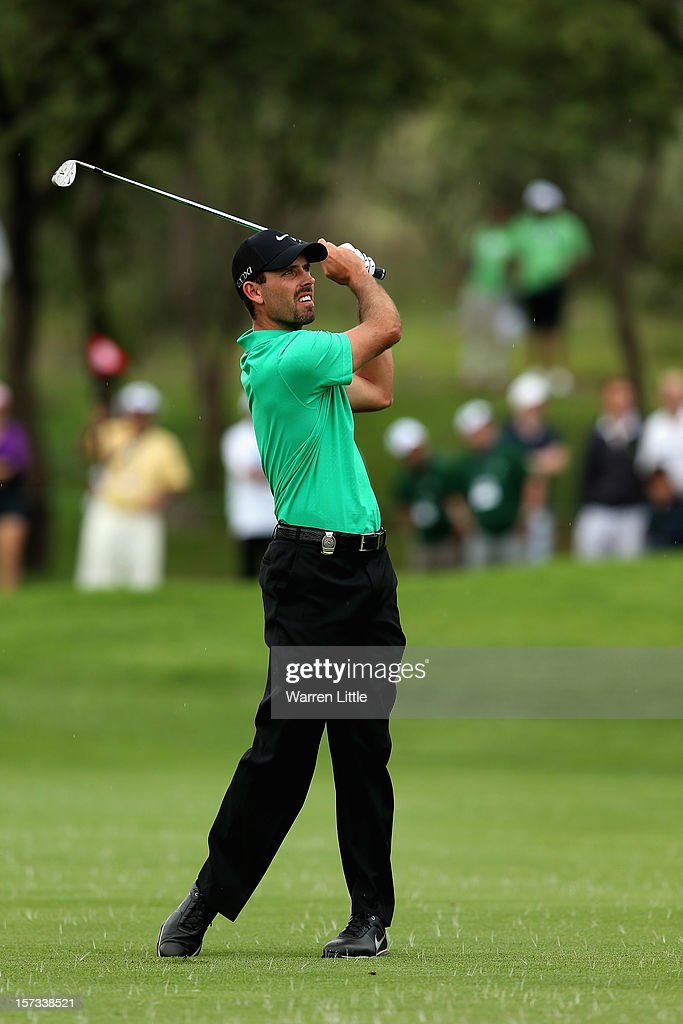 Charl Schwartzel of South Africa plays his second shot into the first green during the final round of the Nedbank Golf Challenge at the Gary Player Country Club on December 2, 2012 in Sun City, South Africa.