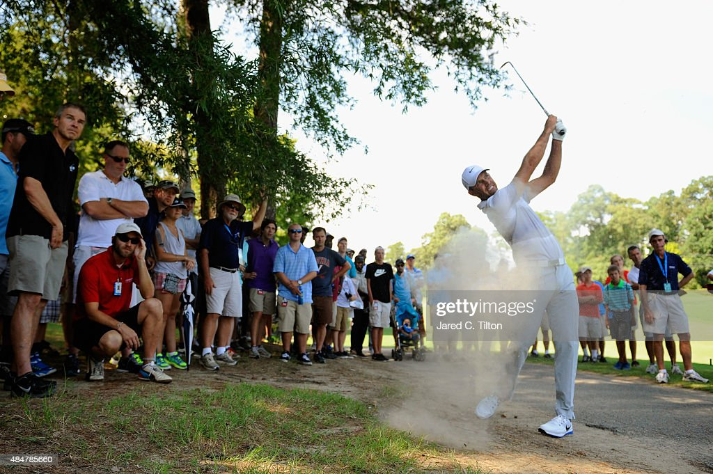 Charl Schwartzel of South Africa plays his second shot out of the dirt on the 11th hole during the second round of the Wyndham Championship at Sedgefield Country Club on August 21, 2015 in Greensboro, North Carolina.