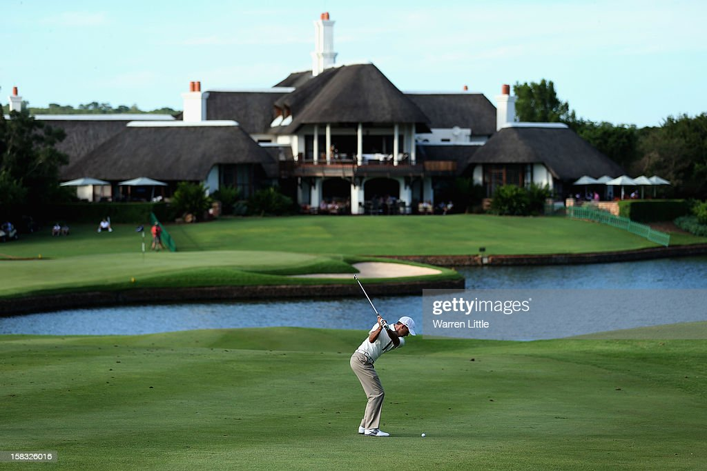Charl Schwartzel of South Africa plays his third shot into the 18th green during the first round of the Alfred Dunhill Championship at Leopard Creek Country Golf Club on December 13, 2012 in Malelane, South Africa.