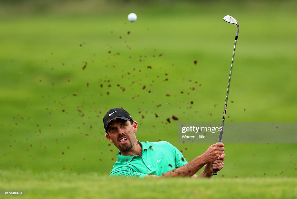 Charl Schwartzel of South Africa plays out of the 10th greenside bunker during the final round of the Nedbank Golf Challenge at the Gary Player Country Club on December 2, 2012 in Sun City, South Africa.