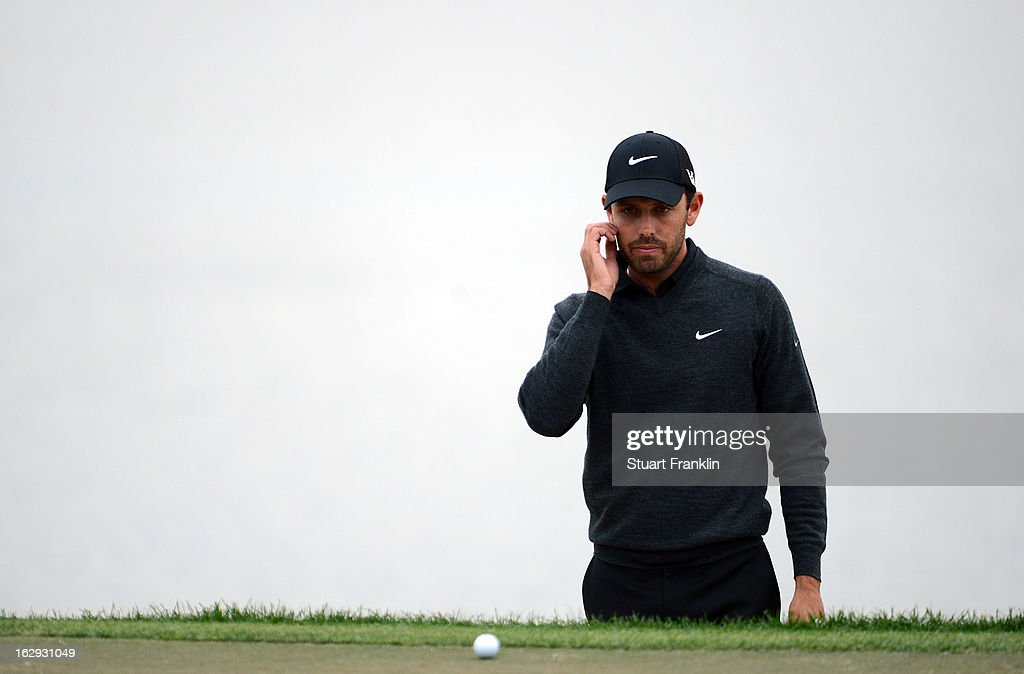 Charl Schwartzel of South Africa ponders a putt on the 18th hole during the second round of the Honda Classic on March 1, 2013 in Palm Beach Gardens, Florida.
