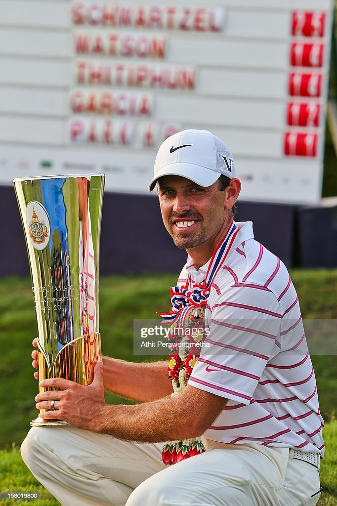 <a gi-track='captionPersonalityLinkClicked' href=/galleries/search?phrase=Charl+Schwartzel&family=editorial&specificpeople=213793 ng-click='$event.stopPropagation()'>Charl Schwartzel</a> of South Africa poses with the Thailand Golf Championship after winning the 2012 Thailand Golf Championship at Amata Spring Country Club on December 9, 2012 in Bangkok, Thailand.