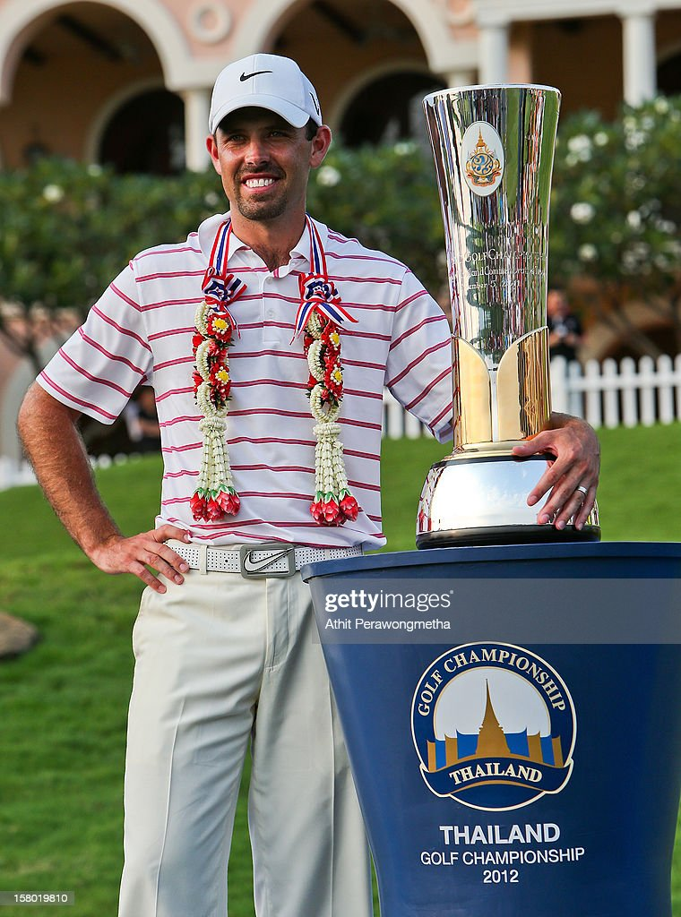 Charl Schwartzel of South Africa poses with the Thailand Golf Championship after winning the 2012 Thailand Golf Championship at Amata Spring Country Club on December 9, 2012 in Bangkok, Thailand.