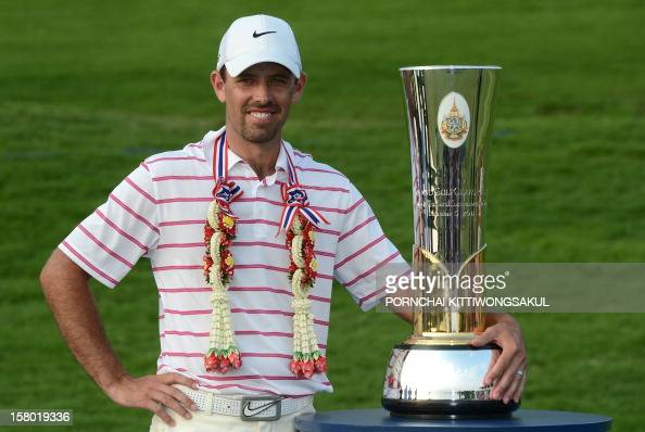 Charl Schwartzel of South Africa poses with the trophy after winning the Thailand Golf Championship at Amata Spring Country Club in Chonburi province...