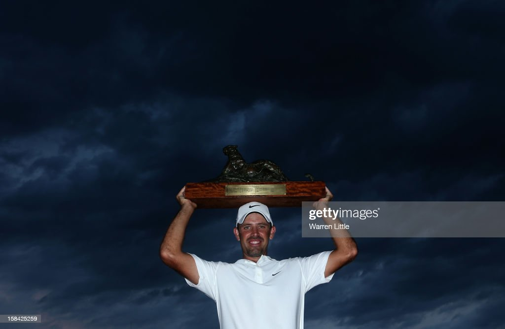 <a gi-track='captionPersonalityLinkClicked' href=/galleries/search?phrase=Charl+Schwartzel&family=editorial&specificpeople=213793 ng-click='$event.stopPropagation()'>Charl Schwartzel</a> of South Africa poses with the trophy after winning the Alfred Dunhill Championship on a score of -24 at Leopard Creek Country Golf Club on December 16, 2012 in Malelane, South Africa.